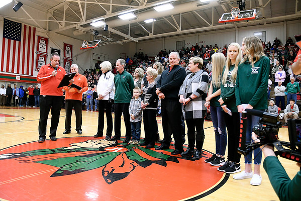 The Buck family was at center court Tuesday evening as Anderson High School dedicated the Teepee floor as Phil Buck Court before the start of the boys basketball game against Pendleton Heights.