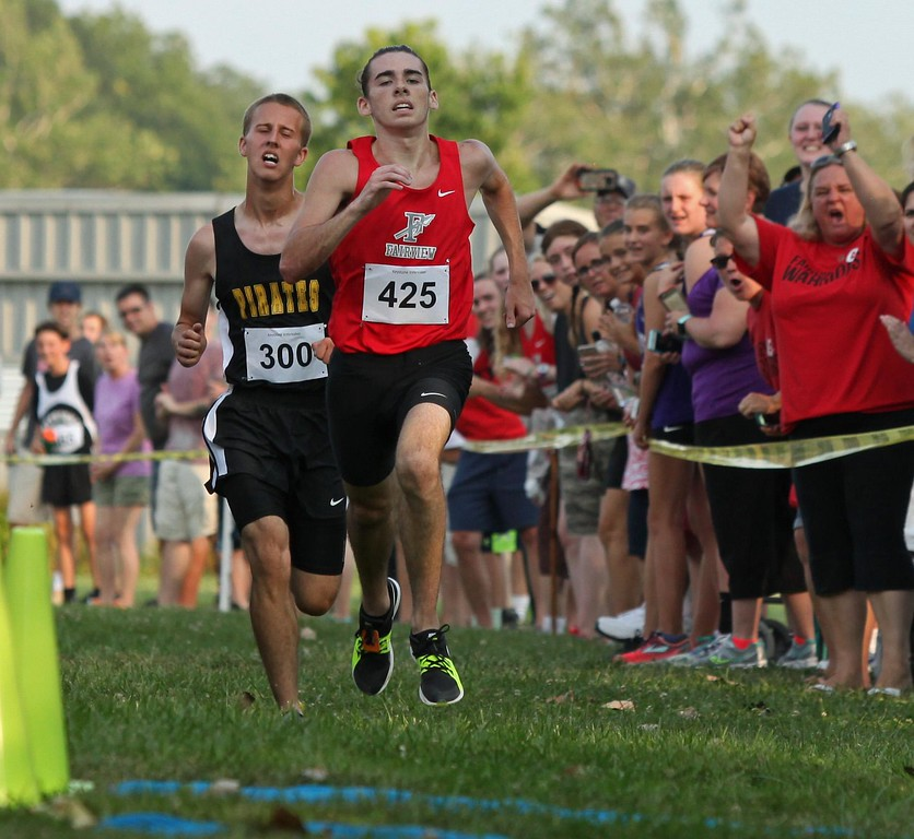 . Randy Meyers - The Morning Journal<br> Conner Kilbane of Fairview edges Russell Schultz of Black River at the finish for first place at the Keystone Icebreaker Invitational on Aug. 21.