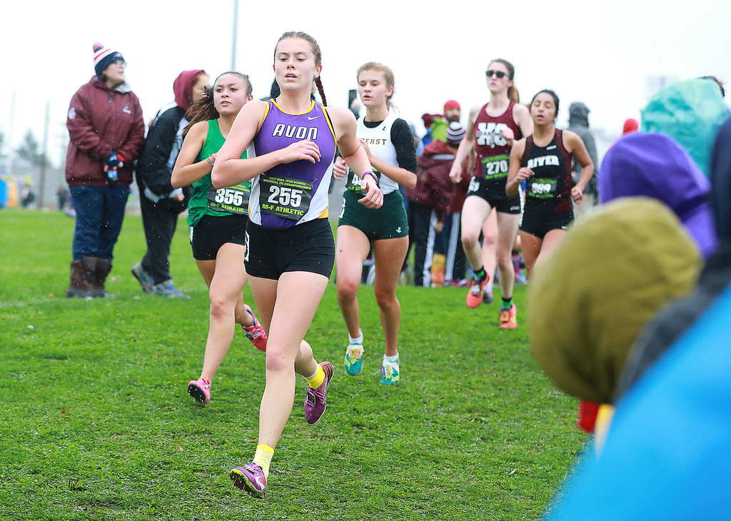 . Anton Albert - The Morning Journal<br> Avon\'s Abby King leads a pack that includes Amherst\'s Kalyn Potyrala and Rocky River\'s Mafe Chaves-Bernal during the Division I Youngstown Region meet at Boardman on Oct. 28.