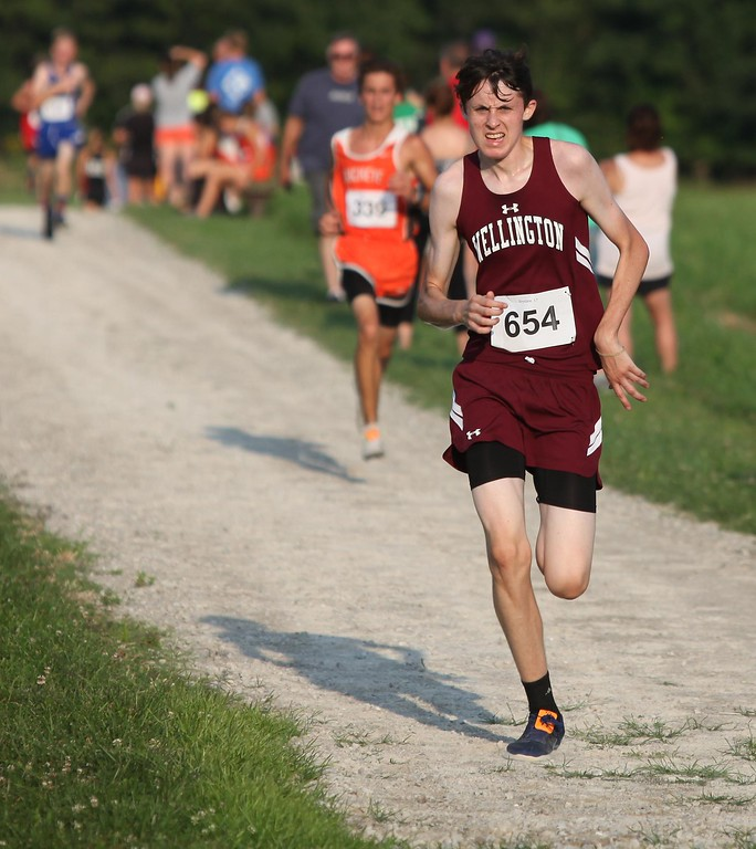 . Randy Meyers - The Morning Journal<br> Wellington\'s Henry Haas makes the last turn towards the finish during the boys race at the Keystone Icebreaker Invitational on Aug. 21.