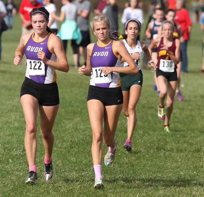 . Randy Meyers - The Morning Journal<br> Avon\'s Jules Frombach and Claudia Hermann are side by side in second place after the third turn during the Divsion I District meet on Oct. 21.