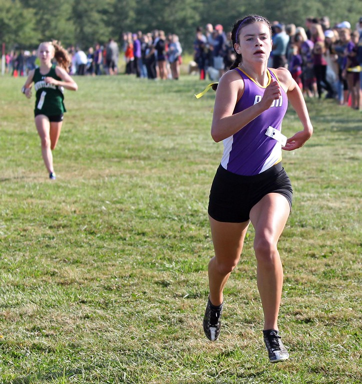 . Randy Meyers - The Morning Journal<br> Avon\'s Jules Frombach sprints toward a first place finish ahead of Westlake\'s Emma Jaros at the Southwestern Conference Preview on Aug. 26.