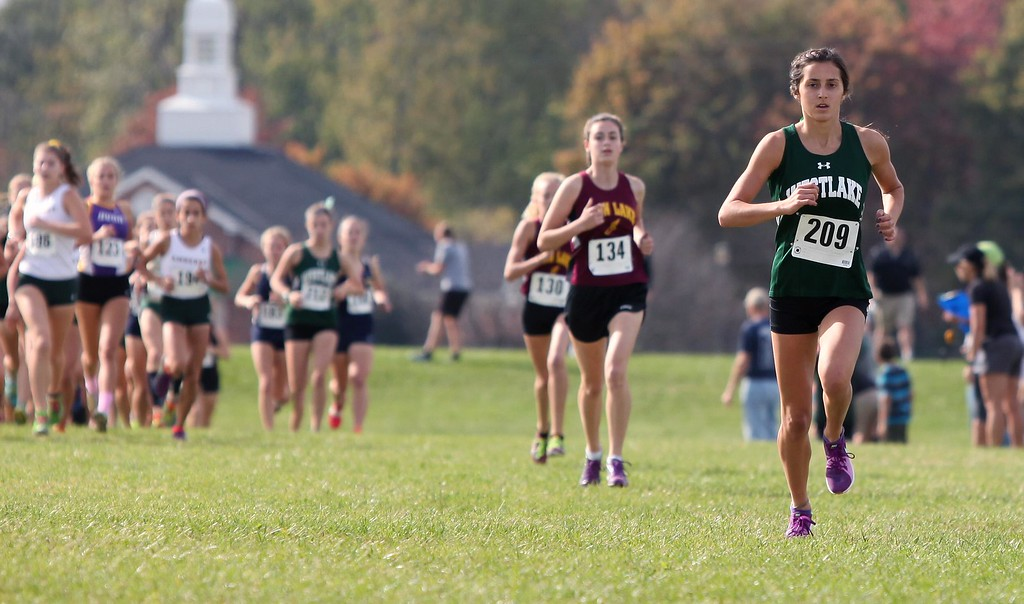 . Randy Meyers - The Morning Journal<br> Westlake\'s Erica Francesconi has the lead after the first hill during the Division I girls District meet on Oct. 21.