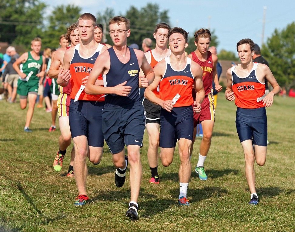 . Randy Meyers - The Morning Journal<br> Runners approach a turn during the boys race at the Southwestern Conference Preview held on Aug. 26 at LCCC.