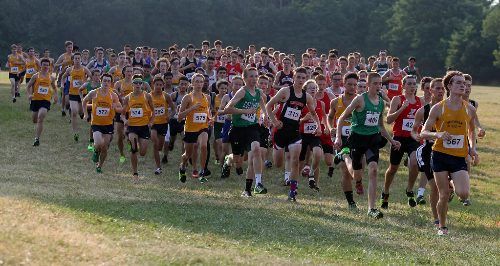 . Randy Meyers - The Morning Journal<br> Runners start the boys race at the Keystone Icebreaker Invitational on Aug. 21.