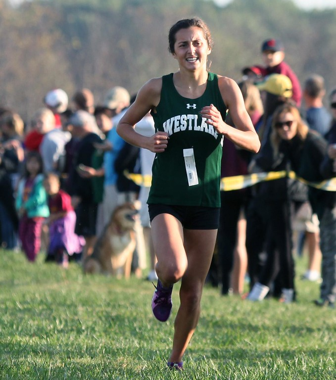 . Randy Meyers - The Morning Journal<br> Westlake\'s Erica Francesconi nears the finish line alone and in first place during the girls race at the Southwestern Conference Championship on Oct. 14.