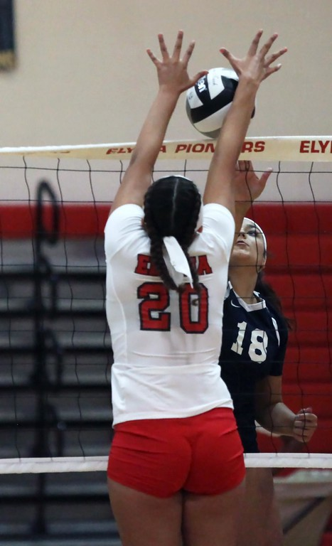 . Randy Meyers - The Morning Journal<br> Elyria\'s Haley Schultz blocks the spike at the net for a point against Lailah Carrion of Lorain on Aug. 24.