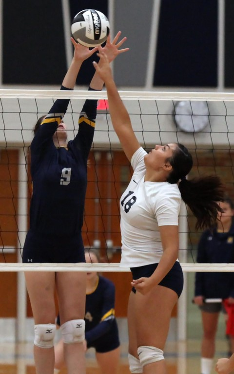 . Randy Meyers - The Morning Journal<br> Jamison Turay of North Ridgeville blocks the tap at the net by Lailah Carrion of Lorain during the first set on Sept. 16.