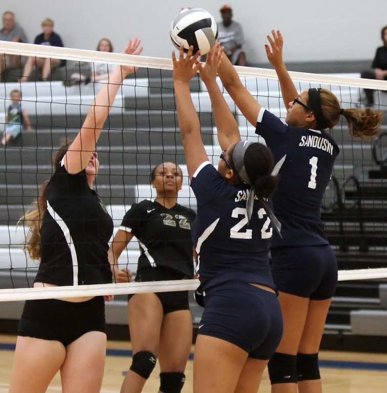 . Randy Meyers - The Morning Journal<br> Sandusky\'s Andra Grant and Peyton Smith partially block the tap at the net by Leanna Rogers of Clearview on Sept. 23.