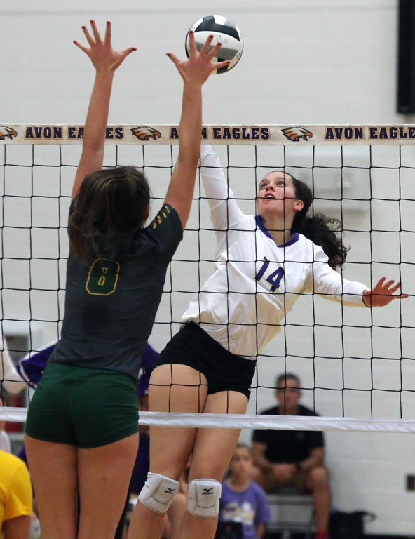 . Randy Meyers - The Morning Journal<br> Avon\'s Katie Koziarz spikes the ball over Sarah Weigand of Amherst during the first set on Nov. 14.
