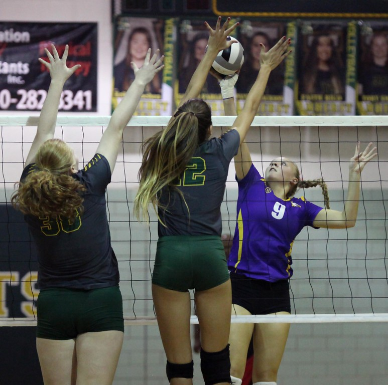. Randy Meyers - The Morning Journal<br> Avon\'s Gillian Romanchok has her tip partially blocked by Faith Rico of Amherst during the second set on Oct. 10.