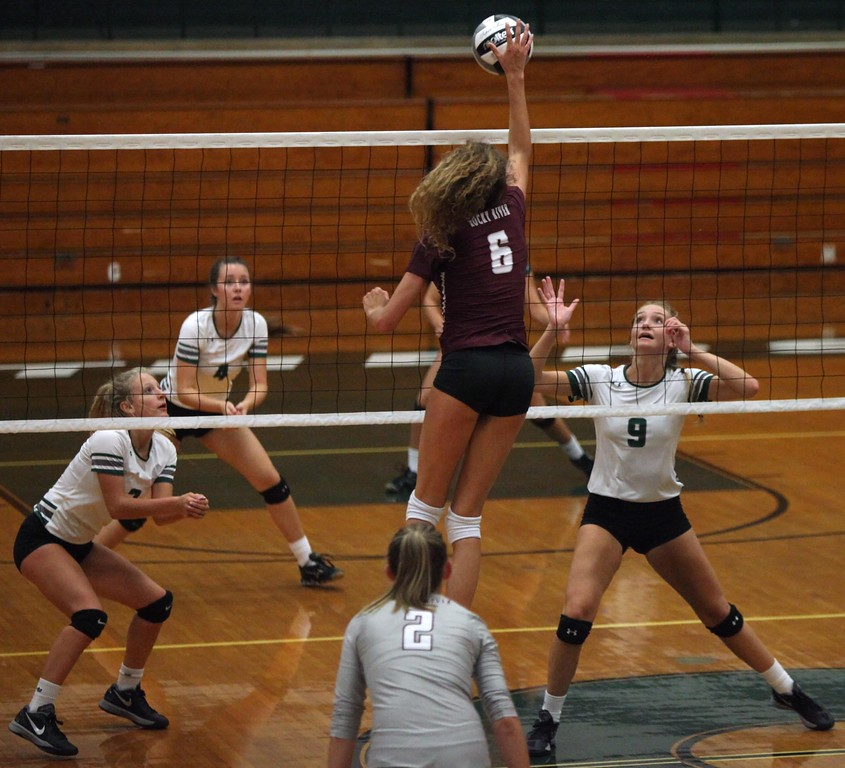 . Randy Meyers - The Morning Journal<br> Rocky River junior Ava Rauser goes up high and spikes the ball for a point against the Elyria Catholic defense on Aug. 29.