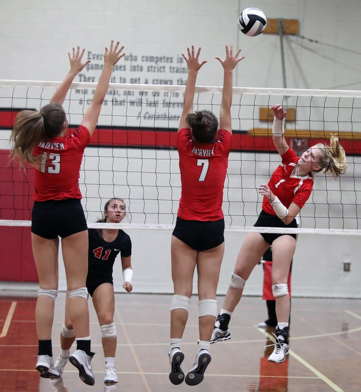 . Randy Meyers - The Morning Journal<br> Sydney LaPointe of Lutheran West spikes the ball over Erin Chambers and Meghan Sozio of Fairview on Nov. 12.