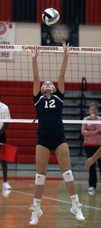 . Randy Meyers - The Morning Journal<br> Lorain\'s Maleigha Amador sets the ball for a teammate during the second set against Elyria on Aug. 24.