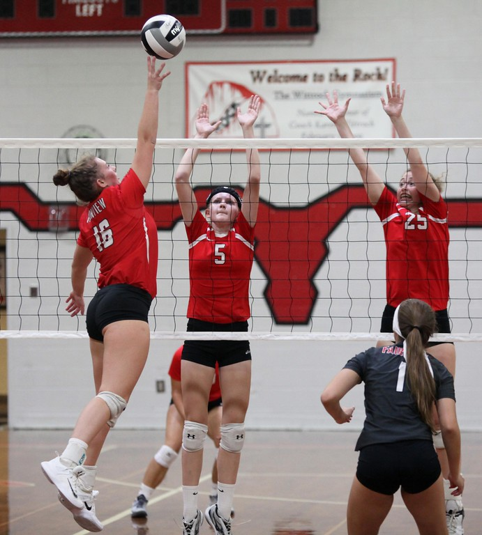 . Randy Meyers - The Morning Journal<br> Hannah Minnich of Fairview taps the ball over Grace Capretta and Rachael Graham of Lutheran West for the point during the first set on Nov. 12.