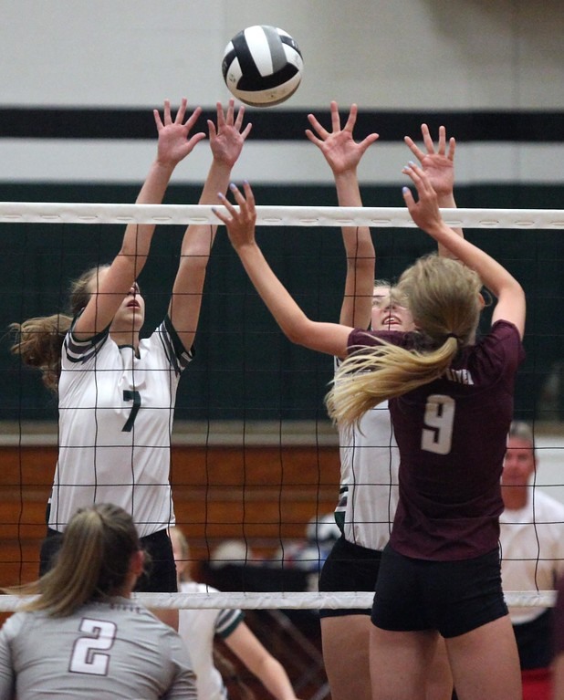 . Randy Meyers - The Morning Journal<br> Rocky River\'s Rachael Waite taps the ball over Elyria Catholic\'s Haley Raible and Grace Schuckman at the net for a point on Aug. 29.
