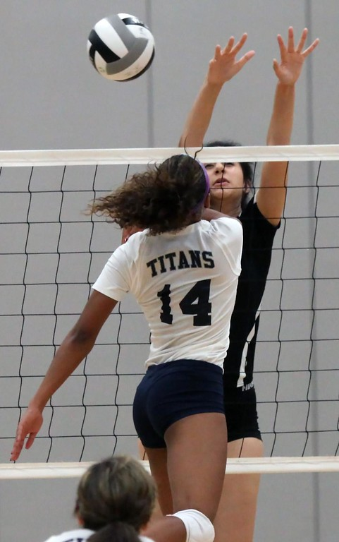 . Randy Meyers - The Morning Journal<br> Seven Townsel of Lorain taps the ball past Clearview\'s Brianna Cirilo during the second set on Sept. 23.