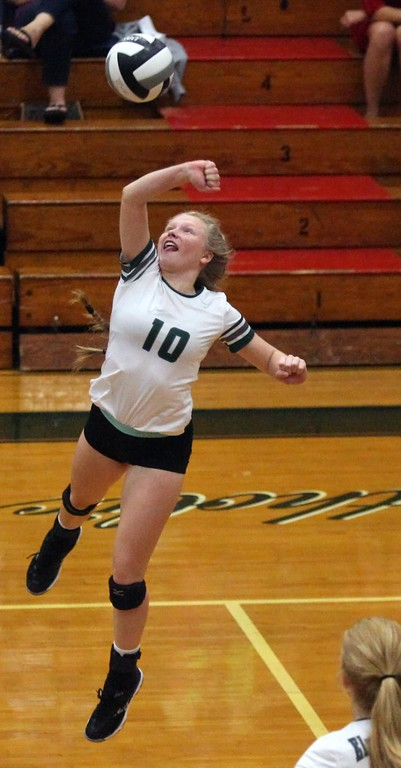 . Randy Meyers - The Morning Journal<br> Elyria Catholic\'s Julia Allegretto returns the ball against Rocky River during the second set on Aug. 29.