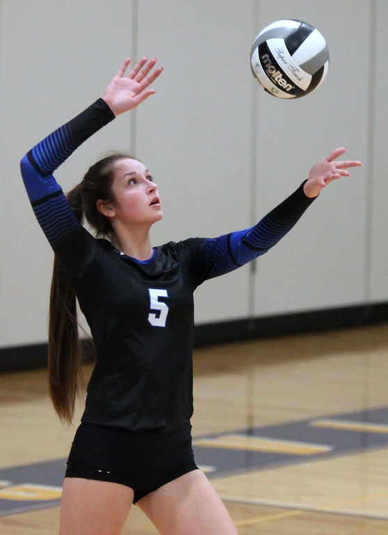 . Randy Meyers - The Morning Journal<br> Elizebeth Grella of Midview prepares to serve during the first match of the Lorain County Senior All-Star game on Nov. 14.