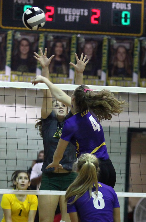 . Randy Meyers - The Morning Journal<br> Sydney Stone of Avon spikes the ball over Payton Jackson of Amherst during the first set on Oct. 10.