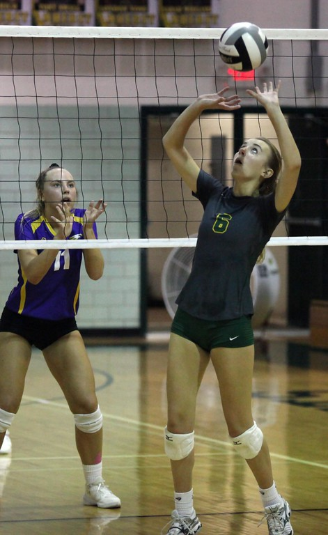 . Randy Meyers - The Morning Journal<br> London Voss of Amherts sets the ball as Avon\'s Katie Sopko gets ready to defend during the second set on Oct. 10.
