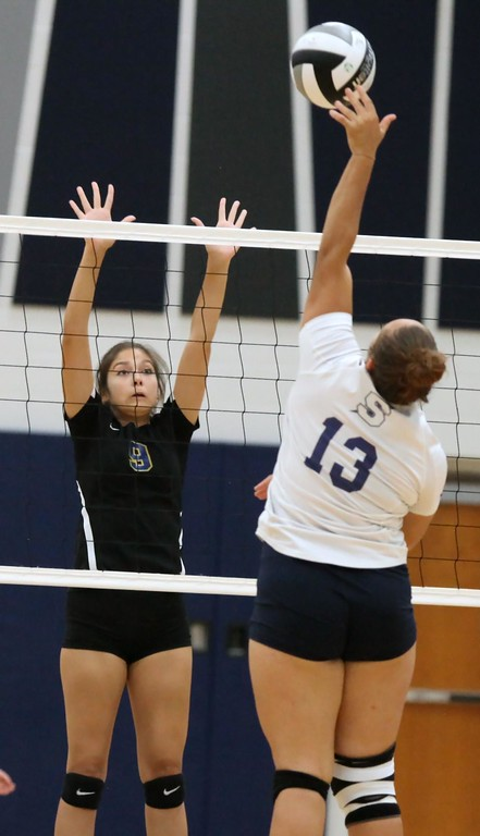 . Randy Meyers - The Morning Journal<br> Mariah Clinton of Sandusky taps the ball towards Madilyn Love of Clearview during the first set on Sept. 23.
