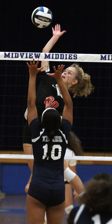 . Randy Meyers - The Morning Journal<br> Elyria\'s McKenna Keir spikes over Sydney Patterson of Lorain during the first set on Oct. 18.