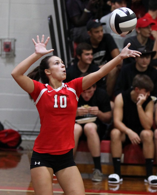 . Randy Meyers - The Morning Journal<br> Nicole Dinardo of Lutheran West serves against Fairview during the second set on Nov. 12.