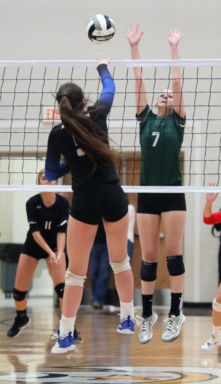 . Randy Meyers - The Morning Journal<br> Midview\'s Elizebeth Grella spikes the ball past Haley Raible of Elyria Catholic during the first match at the Lorain County Senior All-Star Game on Nov. 14.