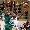 John P. Cleary | The Herald Bulletin<br /> Pendleton's Davrick Black protects the ball as Westfield's Chris Chin tries to block Black's drive to the basket.