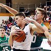 John P. Cleary | The Herald Bulletin<br /> Pendleton's Tristan Ross grabs a rebound against  Westfield's Camden Simons.
