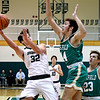 John P. Cleary | The Herald Bulletin<br /> Pendleton's Damieon Warrum alters his shot as he drives the lane against Westfield's Zach Byrer.