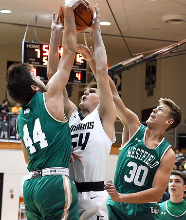 John P. Cleary | The Herald Bulletin<br /> Pendleton's Tristan Ross goes up for a shot but gets it blocked by Westfield's Zach Byrer but get his own rebound and is fouled on the play.