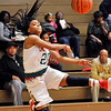 John P. Cleary |  The Herald Bulletin<br /> Anderson's Antaria Hammond flips the ball back inbounds as she falls out of bounds to save it.