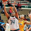 John P. Cleary |  The Herald Bulletin<br /> Anderson's Tiana Ford gets position on Marion's Jazmyn Turner for a basket.