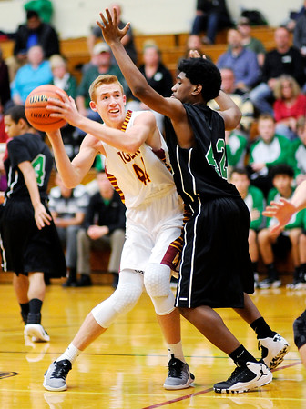 Don Knight | The Herald Bulletin<br /> Alexandria's Dane Hueston looks to shoot against Yorktown's Gerry Hall at Alexandria on Tuesday.