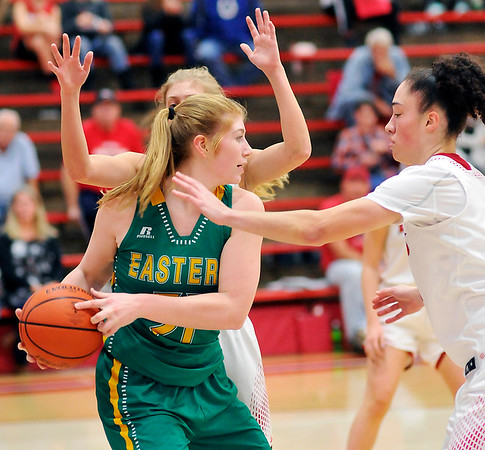 John P. Cleary |  The Herald Bulletin<br /> Frankton's Sydney Tucker and Destyne Knight  put the defensive pressure on Eastern's Hailey Holliday