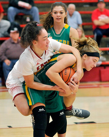 John P. Cleary |  The Herald Bulletin<br /> Frankton's Destyne Knight ties up Eastern's McKenzie Cooper for a jump ball.