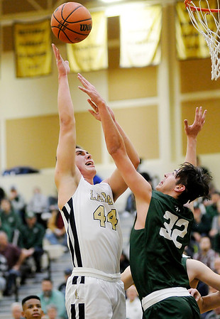 Don Knight | The Herald Bulletin<br /> Lapel's Luke Richardson shoots as he is guarded by Pendleton Heights' Damieon Warrum on Friday.