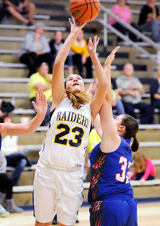 Don Knight | The Herald Bulletin<br /> Shenandoah's Alex Canaday shoots as the Raiders hosted Elwood on Thursday.
