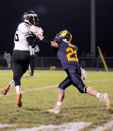 Don Knight | The Herald Bulletin<br /> Lapel's Justin Engle pulls in a pass as he is covered by Shenandoah's Joe Huff on Friday.