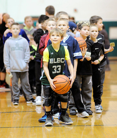 Don Knight | The Herald Bulletin<br /> Dylan John steps up to the free throw line for a chance to win a two liter pop as kids line up behind him and wait for their chance during halftime of the Pendleton Heights game against New Palestine on Friday. Proceeds from the fundraiser benefited Pendleton Heights post prom.