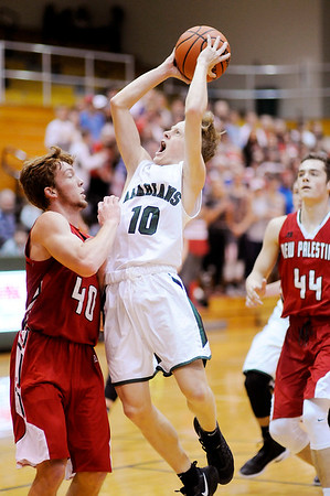 Don Knight | The Herald Bulletin<br /> Pendleton Heights' Karsten Windlan shoots over New Palestine's Dylan Romine on Friday.