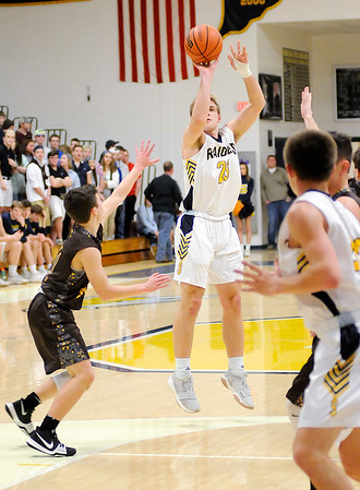 Don Knight |  The Herald Bulletin<br /> Shenandoah's Braydin Myers shoots as the Raiders hosted Monroe Central on Saturday.