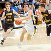 Don Knight |  The Herald Bulletin<br /> Shenandoah's Chase Kinsey drives to the basket on a fast break as he is pursued by Monroe Central's Israel Nash and Lane Lewis on Saturday.