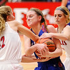 Don Knight |  The Herald Bulletin<br /> Frankton's Sydney Tucker (12) forces a jump ball as she grabs the ball from Elwood's Maleah Ruder as Frankton's Ava Gardner also grabs for the ball on Saturday.