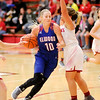 Don Knight |  The Herald Bulletin<br /> Elwood's Gabby Leavell draws a foul from Frankton's Aleyah Rastetter as the Eagles hosted the Panthers on Saturday.