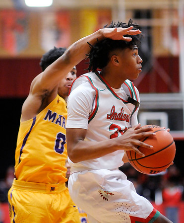 Don Knight | The Herald Bulletin<br /> Anderson's Dayveon Turner drives the baseline as the Indians hosted the Marion Giants on Tuesday.