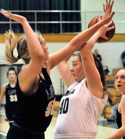 John P. Cleary | The Herald Bulletin<br /> Pendleton's Laikyn Conner looks for an outlet pass as Lapel's Breanna Boles pressures the ball.
