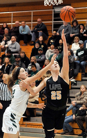 John P. Cleary | The Herald Bulletin<br /> Lapel's Lexi Swanson gets the finger roll as Pendleton's Lauren Landes tries to defend the shot.